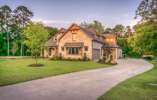 Large brick house outside - selling an indebted home